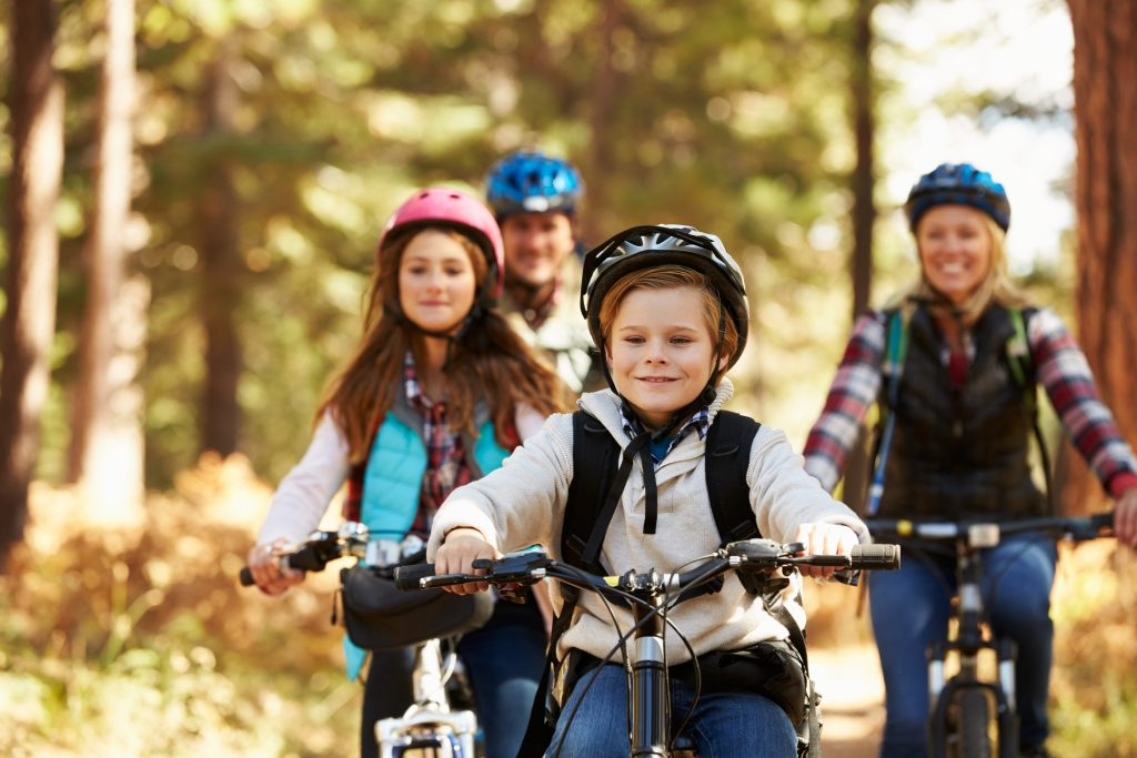 Family Mountain Biking On Forest Trail, Front View, Close Up