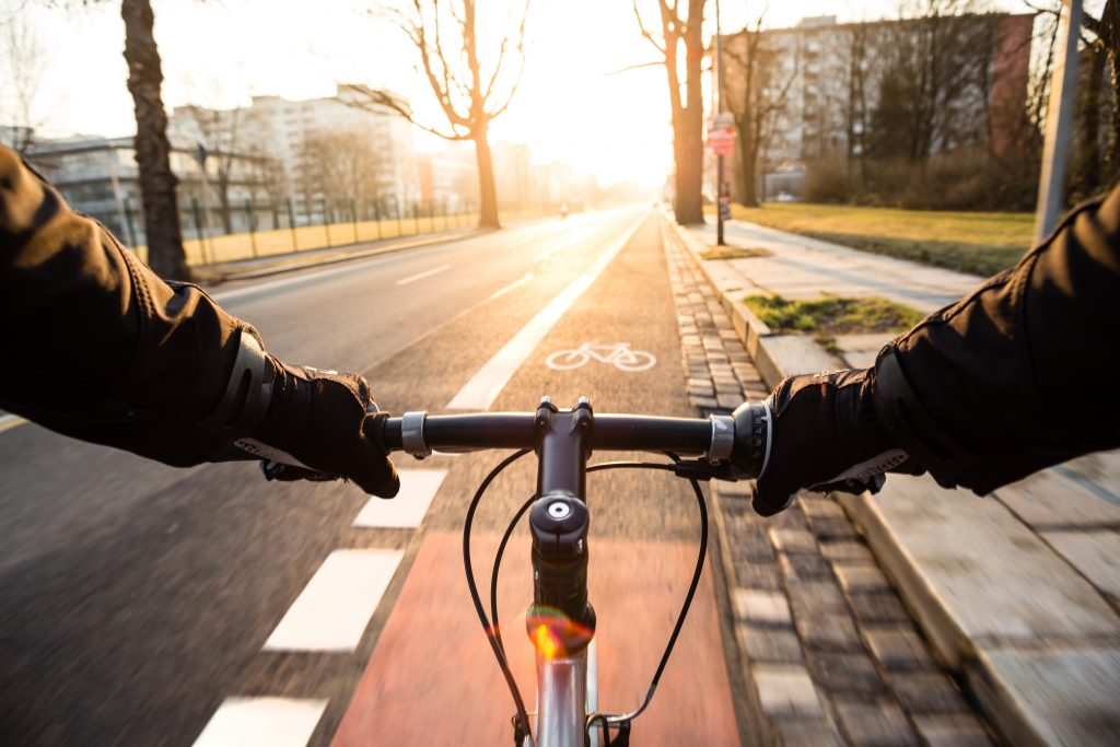 First Person View Of Cyclist In The City At Morning
